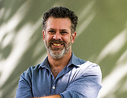 Pictured: Michael Redhill <br /> <br /> <br /> Michael Redhill is an American-born Canadian poet, playwright and novelist. He also writes under the pseudonym Inger Ash Wolfe.