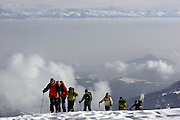 Gulmarg, Kashmir. The stunning vista of the winter Himalayas provides the backdrop for a party of British and Italian skiers led by the veteran Australian skier John Faulkner at the top of the Gulmarg gondola (3980m). The gondola which opened in 2005 is the worlds highest and has been drawing snowboarders and skiers from around the world. Gulmarg is only 10km from the line of control that seperates Pakistan Kashmir from Indian Kashmir which means its situated in a conflict area. But improved relations between the two countries as well as a peace process within Kashmir have meant more skiers are now flocking to the area for what is said to be some of the best skiing in the world.