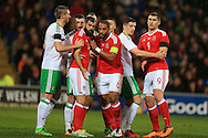 Ashley Williams  (6) and Joe Ledley of Wales get involved with some pushing and shoving as they wait for a corner to be taken. Wales v Northern Ireland, International football friendly match at the Cardiff City Stadium in Cardiff, South Wales on Thursday 24th March 2016. The teams are preparing for this summer's Euro 2016 tournament.     pic by  Andrew Orchard, Andrew Orchard sports photography.
