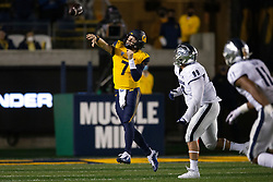 California quarterback Chase Garbers (7) throws on the run as he's pursued by Nevada defensive tackle Dom Peterson (99) during the fourth quarter of an NCAA college football game, Saturday, Sept. 4, 2021, in Berkeley, Calif. (AP Photo/D. Ross Cameron)