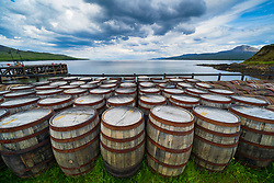 View of scotch whisky barrels at Bunnahabhain Distillery on island of Islay in Inner Hebrides of Scotland, UK