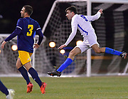 St. Louis University forward Stefan Stojanovic (right) follows through on a shot on goal. St. Louis University played the University of Missouri - Kansas City in men's soccer on February 3, 2021 at Robert Hermann Stadium on the SLU campus in St. Louis, MO.<br /> Tim Vizer/For the Post-Dispatch