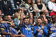 George Francombe lifting the trophy following the Sky Bet League 2 play off final match between AFC Wimbledon and Plymouth Argyle at Wembley Stadium, London, England on 30 May 2016.