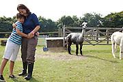 Isy Large and Joseph, 12, with the alpacas at Hares Farm. CREDIT: Vanessa Berberian for The Wall Street Journal<br /> UKFARM-Hares Farm