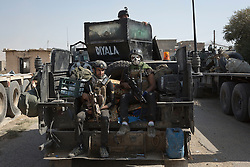 Licensed to London News Pictures. 23/10/2016. Two Iraqi Army counter terrorism soldiers travel on the back of an armoured Humvee in the recently captured Iraqi town of Bartella.<br /> <br /> Bartella, a mainly Christian town with a population of around 30,000 people before being taken by the Islamic State in August 2014, was captured two days ago by the Iraqi Army's Counter Terrorism force as part of the ongoing offensive to retake Mosul. Although ISIS militants were pushed back a large amount of improvised explosive devices are still being found in the town's buildings. Photo credit: Matt Cetti-Roberts/LNP