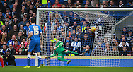 Brighton goalkeeper David Stockdale is unable to prevent Middlesbrough FC striker Enrique Garcia Kike from opening the scoring during the Sky Bet Championship match between Brighton and Hove Albion and Middlesbrough at the American Express Community Stadium, Brighton and Hove, England on 19 December 2015. Photo by Bennett Dean.