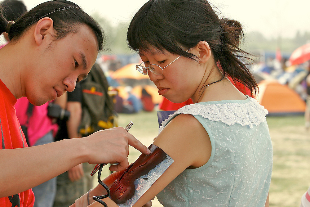 Airbrushed body art was one of the amenities available at Midi Music Festival in Beijing China 2007.  Midi is a Chinese alternative music concert that lasts 4 days and features Chinese and international bands.