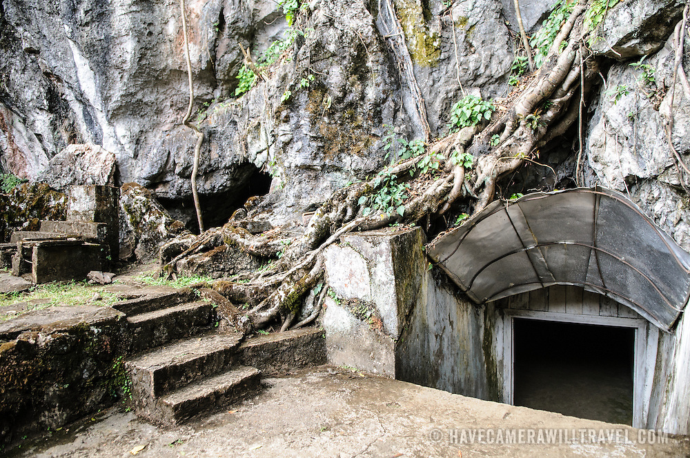 An entrance to one of the caves at the Pathet Lao Caves of Vieng Xai in Houaphanh Province in northeastern Laos. It was in these natural caves deep in karsts that the Pathet Lao leadership avoided constant American bombing raids during the Vietnam War.