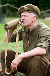 A re-enactor portrays a member of the British 5th Battalion, East Yorkshires, 50th Division drinks from his water bottle. SPAM 1940's Weekend Heckmonwyke near Wakefield 10 July 2010 <br /> Images © Paul David Drabble