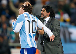 Diego Maradona (L) and Lionel Messi (R) of Argentina celebrate after the 2010 FIFA World Cup South Africa Round of Sixteen match between Argentina and Mexico at Soccer City Stadium on June 27, 2010 in Johannesburg, South Africa. (Photo by Vid Ponikvar / Sportida)