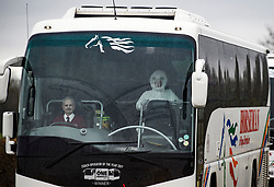 © Licensed to London News Pictures. 31/01/2020. Brize Norton, UK. A person dressed in a medical suit sits beside the driver as coaches carrying passengers leave the airport, after a plane carrying British Nationals from Wuhan in China to the UK landed at RAF Brize Norton in Oxfordshire. The flight, carrying 83 Britons and 27 foreign nationals from the centre of the coronavirus outbreak, was initially delayed because of a lack of clearance by Chinese Authorities. Photo credit: Ben Cawthra/LNP