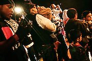 Spectators are taking part to the final moments on stage of the 'Palestine - The Album', a music collection recorded by many different artists in the Islamic Hip Hop scene in London, England, on Saturday, Jan. 6, 2007.  Islamic Hip Hop artists like the duo 'Blind Alphabetz', from London, feel more than ever the need to say what they think aloud. In the music industry the backlash of a disputable Western foreign policy towards Islamic countries and its people is strong. The number of artists in the European Union and the US taking this into consideration and addressing the current social and political problems within their lyrics is growing rapidly and fostering awareness for Muslim and others alike.