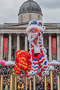 The Flying Lion Dance is performed in front of the National Gallery - Chinese New Year Celebrations in London 2018 marking the arrival of the Year of the Dog. The Event started with a Grand Parade from the North East side of the Trafalgar Square and finishing in Chinatown at Shaftesbury Avenue. It was organised by London Chinatown Chinese Association and is supported by The Mayor of London and Westminster City Council.