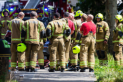 Firefighters are briefed  are at the scene of a fire at The Mall in Walthamstow in North East London, that broke out during rush hour this morning and appears to have destroyed the foodcourt and according to a manager escorted by LFB officials at the adjacent Asda, a large amount of stock. London, July 22 2019.