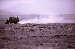 A truck is driven on the barren land of Khost region bordering Pakistan