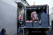 Israel, Haifa, Wadi Nisnas, Interior of a Butcher's van with slaughtered pigs unloading at a butchery