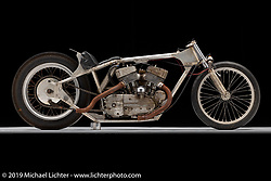 """This bike represents innovation and creativity in the pursuit of going faster. The original pilot was Sam Satterley (""""Slidin' Sammy during his dirt track days). Sammy was known as the """"Arkansas Traveler"""". In his memory, owner Cabana Dan Rognsvoog rechristened the bike """"The Arkansas Traveler."""" Rumor has it that Sam went to Lynwood, California during or after his flat track career, and built this bike. It's a survivor and you see it as it was campaigned in the 1960's. Dan refreshed the motor, having kept the historic integrity of the bike. Photographed by Michael Lichter in Sturgis, SD. July 31, 2019. ©2019 Michael Lichter"""