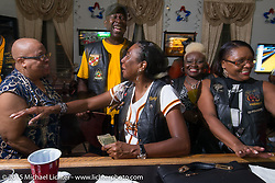 Flying Eagles MC members at the bar during the club meetup at the American Legion in Catonsville, MD, USA. August 16, 2015.  Photography ©2015 Michael Lichter.