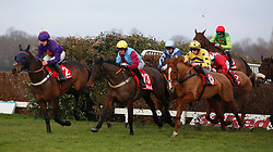 Buywise and Leighton Aspell (red cap) trail the leaders over an early fence before going on to win The 32Red Veterans' Handicap Steeple Chase Race run during 32Red Day at Sandown Park, Sandown.