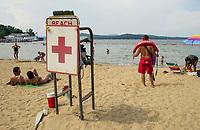 A Lifeguard keeps a watchful eye on swimmers at Weirs Beach.  (Karen Bobotas Photographer)