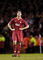 Photo: Jed Wee.<br /> Liverpool v Benfica. UEFA Champions League. 08/03/2006.<br /> <br /> Liverpool's Xabi Alonso shows his disappointment.