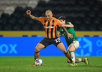Hull City's Josh Magennis shields the ball from Lincoln City's Joe Walsh<br /> <br /> Photographer Chris Vaughan/CameraSport<br /> <br /> EFL Trophy Quarter Final - Hull City v Lincoln City - Tuesday 2nd February 2021 - KCOM Stadium - Kingston upon Hull<br />  <br /> World Copyright © 2021 CameraSport. All rights reserved. 43 Linden Ave. Countesthorpe. Leicester. England. LE8 5PG - Tel: +44 (0) 116 277 4147 - admin@camerasport.com - www.camerasport.com