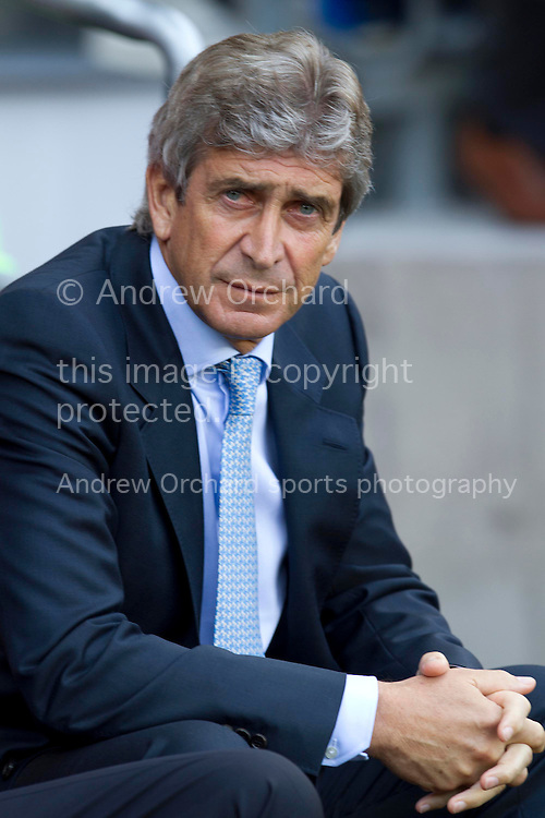 Manager of Manchester City Manuel Pellegrini during the Barclays Premier league match, Cardiff City v Manchester City at the Cardiff City stadium in Cardiff, South Wales on Sunday 25th August 2013. pic by Sophie Elbourn , Andrew Orchard sports photography,