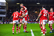Kieffer Moore of Barnsley (19) scores a goal and celebrates with team mates to make the score 2-0 during the EFL Sky Bet League 1 match between Barnsley and Bradford City at Oakwell, Barnsley, England on 12 January 2019.