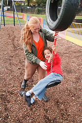 Woman with boy in playground