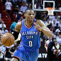 16 March 2011: Oklahoma City Thunder point guard Russell Westbrook (0) brings the ball upcourt during the Oklahoma City Thunder 96-85 victory over the Miami Heat at the AmericanAirlines Arena, Miami, Florida, USA.
