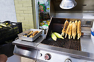 Corn on the cob roasted street side and served with mayonnaise, cheese and chili at El Mercadito snack shop in downtown Woodburn, Oregon