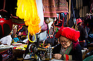 A Red Dao woman at work in the market in Sapa, Vietnam, Asia