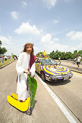 Stock photo of Monkey Jesus riding on a banana scooter