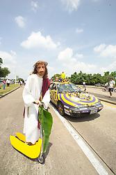 Stock photo of Monkey Jesus riding on a banana scooter
