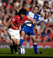 Photo: Jed Wee.<br />Manchester United v Blackburn Rovers. The Barclays Premiership. 24/09/2005.<br /><br />Manchester United's Park Ji Sung (L) is tackled by Blackburn's Paul Dickov.