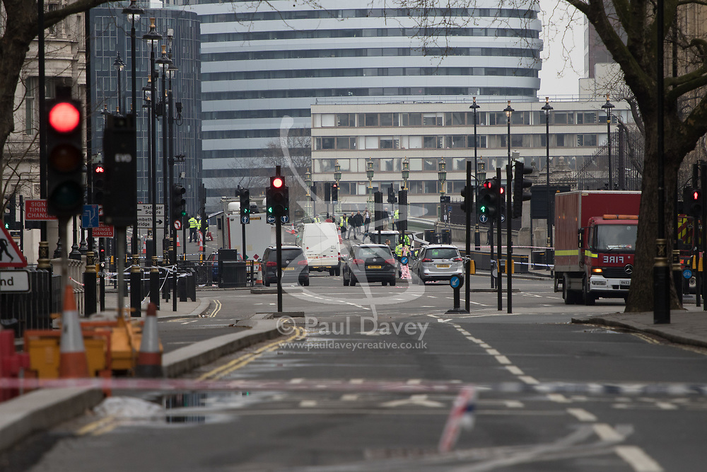 Westminster, London, March 23rd 2017. The scene on Westminster Bridge as clean-up operations continue following Tuesday's terrorist attack on Westminster Bridge and in the grounds of Parliament, in which four people and their attacker were killed with over 40 injured.