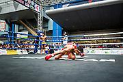 "28 JULY 2013 - BANGKOK, THAILAND:  A boxer performs the ""wai krua"" a pre bout ritual thanking his coaches and teachers during the ASEAN Muay Thai Championship at MBK shopping center in Bangkok.      PHOTO BY JACK KURTZ"