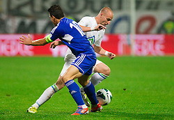 Constantinos Charalambides  of Cyprus  vs Miso Brecko of Slovenia during football match between National teams of Slovenia and Cyprus in 3rd Round of Group E of FIFA World Cup 2014 Qualification on October 12, 2012 in Stadium Ljudski vrt, Maribor, Slovenia. Slovenia defeated Cyprus 2-1. (Photo By Vid Ponikvar / Sportida)