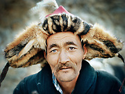 The heterochromia (two different eye color) of Bemprach an eagle hunter. The fur used to make his traditional hat was his eagle's catch.<br /> <br /> Eagle Hunting festival in Western Mongolia, in the province of Bayan Olgii. Mongolian and Kazak eagle hunters come to compete for 2 days at this yearly gathering. Mongolia