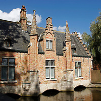 Europe, Belgium, Brugges. Canal buidling in Brugges.
