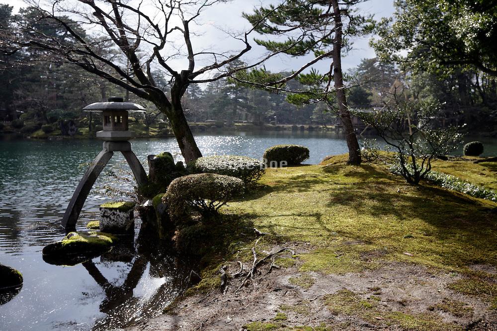 Stone lantern in the Kenrokuen gardens in Kanazawa Japan