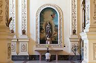 A woman prays inside la Iglesia de San Agustín o San Francisco el Nuevo in Havana, Cuba on 17 Dec 2015