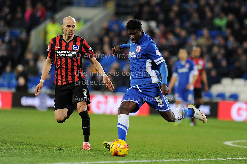 Bruno Ecuele-Manga of Cardiff city ® clears from Brighton's Bruno Saltor. Skybet football league championship match, Cardiff city v Brighton & Hove Albion at the Cardiff city Stadium in Cardiff, South Wales on Tuesday 10th Feb 2015.<br /> pic by Andrew Orchard, Andrew Orchard sports photography.