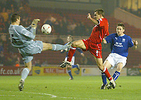 Photo. Andrew Unwin.<br /> Middlesbrough v Everton, Carling Cup Fourth Round, Riverside Stadium, Middlesbrough 03/12/2003.<br /> Everton's Nigel Martyn (l) comes out to challenge Middlesbrough's Szilard Nemeth (c).
