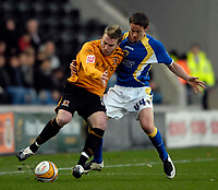 Photo: Jed Wee/Sportsbeat Images.<br /> Hull City v Cardiff City. Coca Cola Championship. 01/12/2007.<br /> <br /> Hull's Stephen McPhee (L) holds off Cardiff's Chris Gunther.