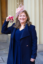 ROTA:  Principal Soil Scientist at the James Hutton Institute Professor Lorna Anne Dawson proudly displays her CBE awarded for services to soil and forensic science at an investiture at Buckingham Palace in London. London, November 13 2018.