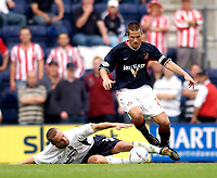 Photo. Jed Wee<br /> Preston North End v Sunderland, Nationwide League Division One, Deepdale, Preston. 23/08/2003.<br /> Sunderland skipper Paul Thirlwell (R) tries to elude the outstretched leg of Preston's Paul McKenna.