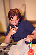 Woman age 25 in her office making important telephone call.  Torun Poland