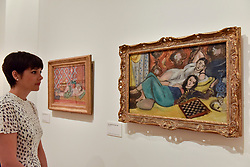 """© Licensed to London News Pictures. 01/08/2017. London, UK. A staff member views (L to R) """"Reclining Odalisque"""", 1926, and """"Two Models Resting"""", 1928.  Preview of """"Matisse in the Studio"""", at the Royal Academy of Arts, Piccadilly, the first exhibition to consider how the personal collection of treasured objects of Henri Matisse were both subject matter and inspiration for his work.  Around 35 objects are displayed alongside 65 of Matisse's paintings, sculptures, drawings, prints and cut-outs.  The exhibition runs 5 August to 12 November 2017.  Photo credit : Stephen Chung/LNP"""