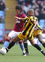 Photo: Dave Linney.<br />Aston Villa v Port Vale. The FA Cup. 28/01/2006.Port Vale's George Abbey(R) gets in a challenge on   Milan Baros